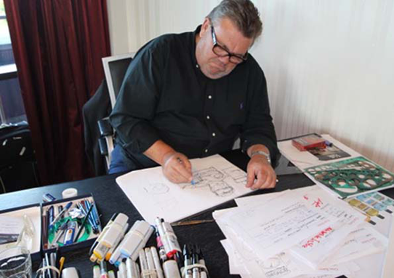 Gus visualising concepts at his desk